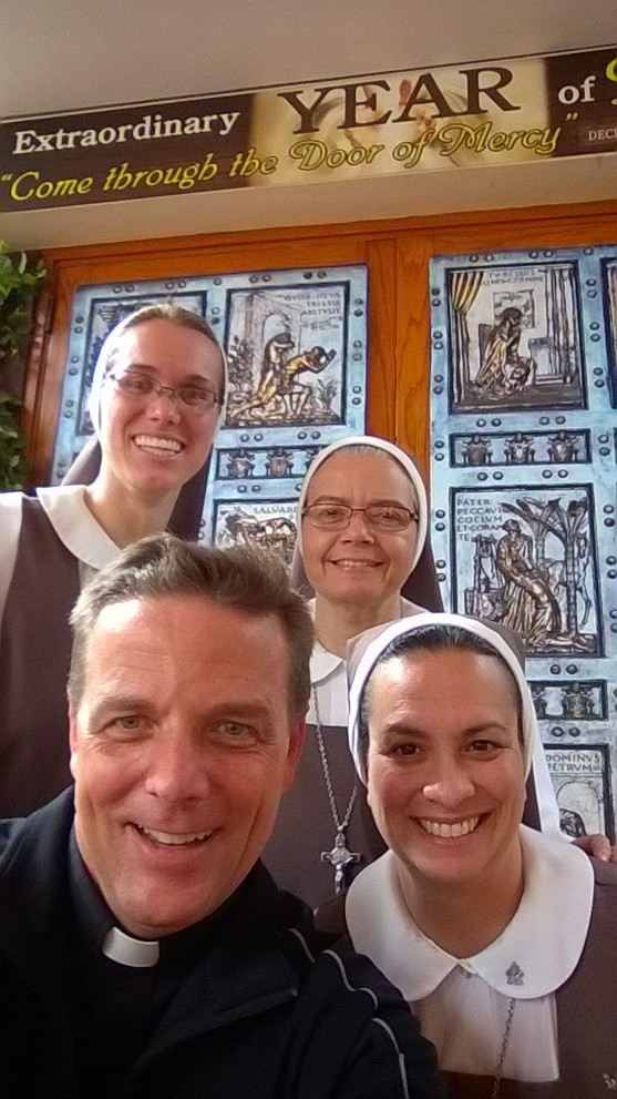 "Pilgrimages captured with a ""Holy Door Selfie"""