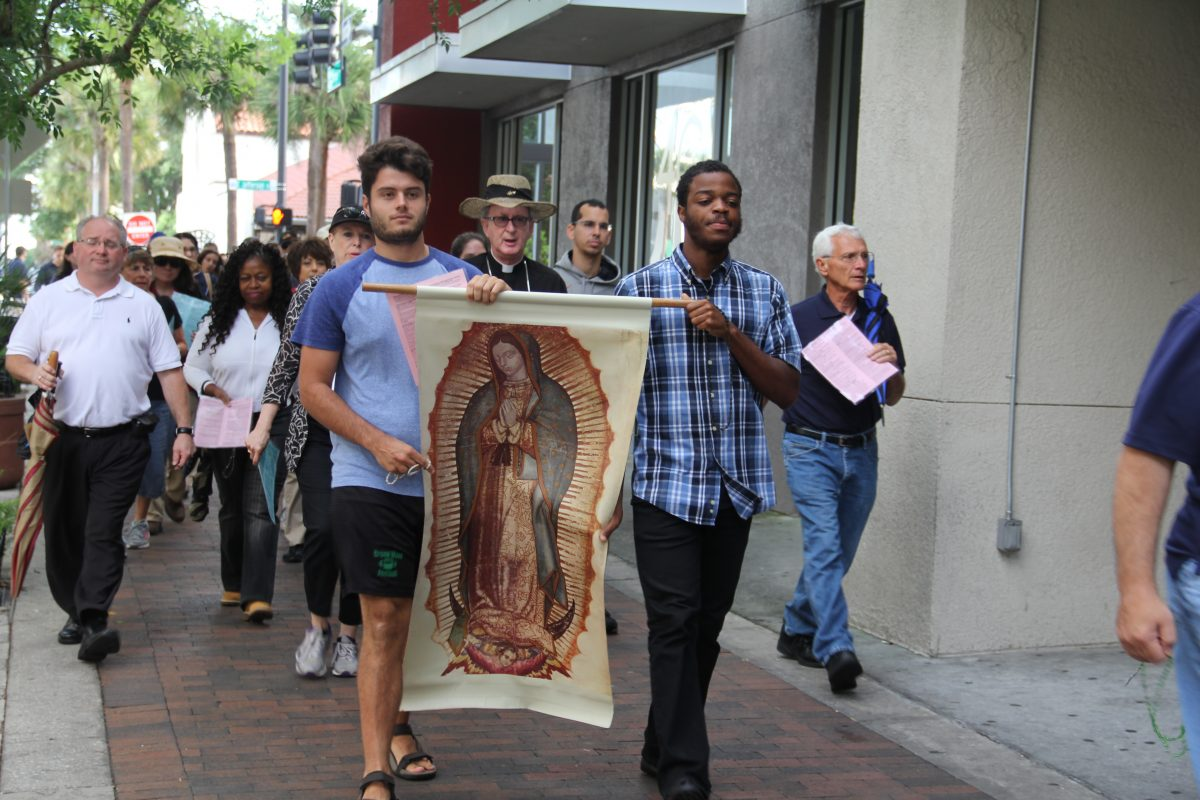 Catholics march down Church Street in Orlando during the Holy Saturday Morning Prayer/Rosary Procession.