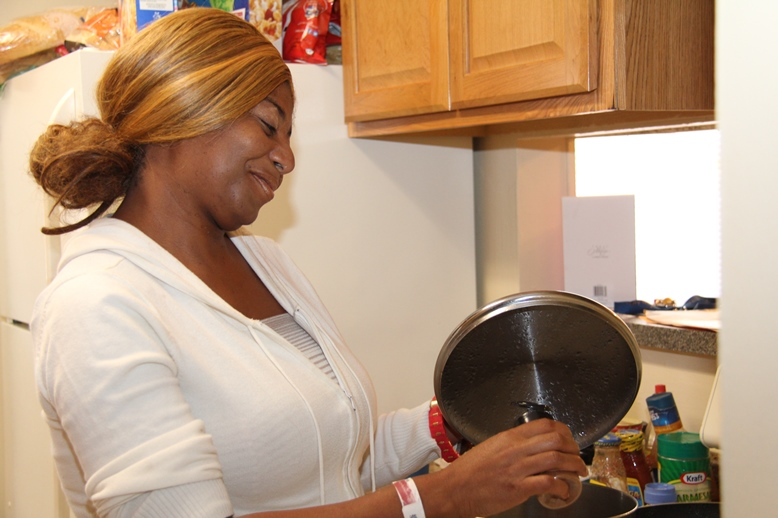 Carmelita Gammons is most grateful for being able to cook in her own home thanks to Catholic Charities and the Rapid Rehousing Program. PHOTO BY GLENDA MEEKINS