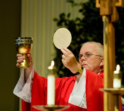 Father John McCormick celebrates Mass at St. James Cathedral where he served as rector since 2001. Father McCormick died September 19. He will be remembered for his sense of humor, loyalty to his sports teams, and most of all for his love of his faith and the people he served.