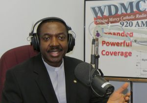 """Father Emmanuel Akalue, pastor of Our Lady of Grace Parish in Palm Bay, hosts a weekly radio show, """"New Evangelization: Catholic Apologetics"""" on Divine Mercy Catholic Radio, using the airwaves to spread the Good News. (COURTESY)"""