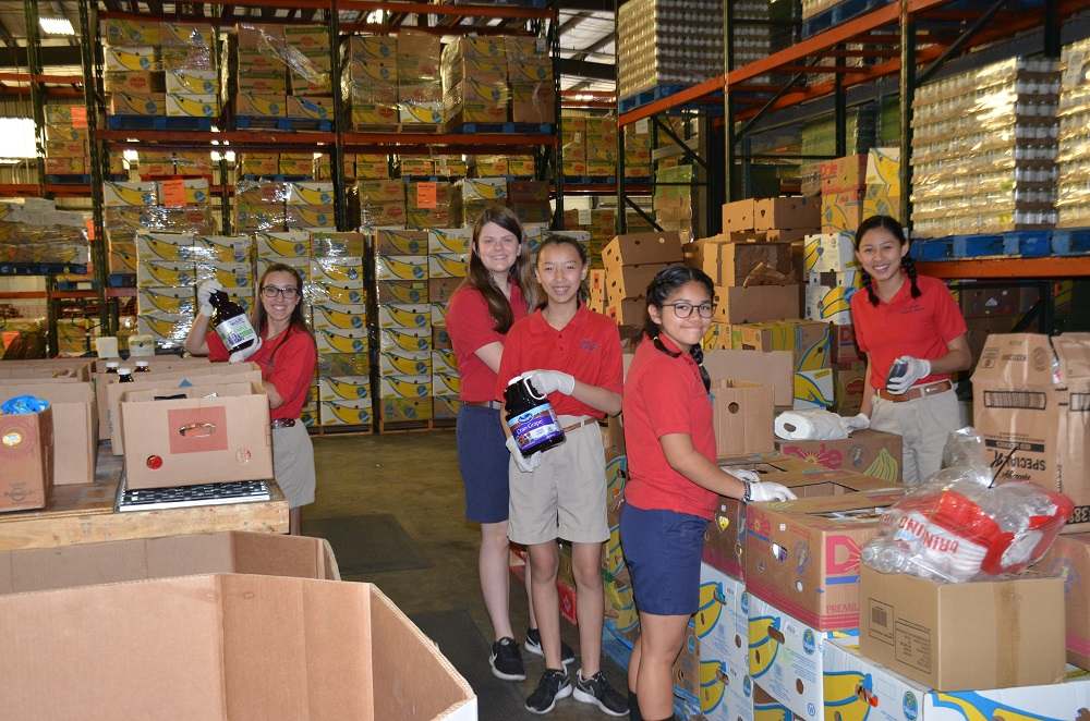 Students Help Sort Food for the Poor